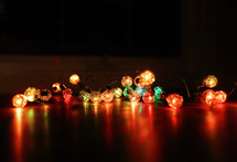coloured Christmas lights on table