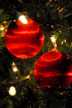 Red satin Christmas tree ornaments.