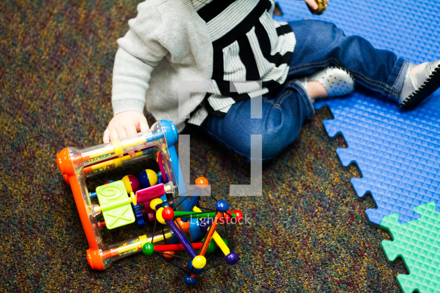 toddlers playing with toys at a church nursery