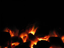 Glowing embers of a charcoal fire.