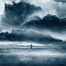 man standing scratching his head in front of a giant wave and wall of water
