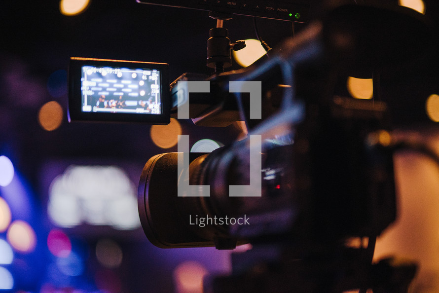 video camera recording a contemporary worship service