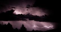 lightning streak across a night sky