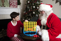 A boy and Santa playing connect four