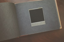 a blank polaroid on album page