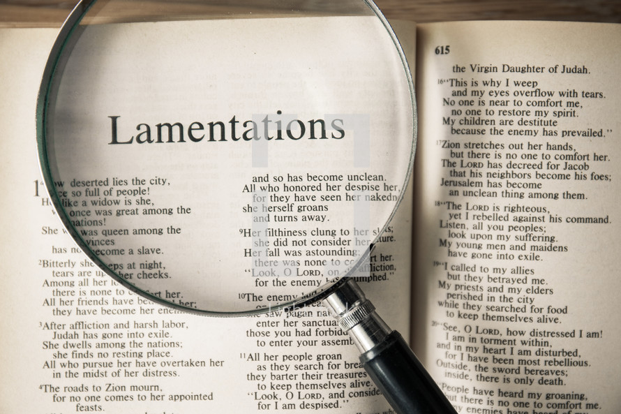 magnifying glass over Bible - Lamentations