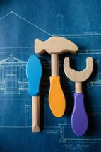 toy tools on blueprints