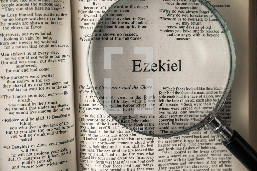 magnifying glass over Bible - Ezekiel