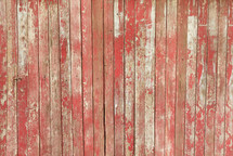 weathered red boards on a barn