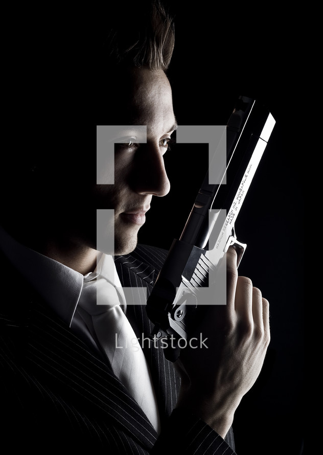 White-Collar Crime; man in suit holding pistol.