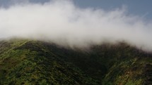 clouds forming on a mountaintop