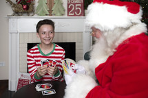 a boy and Santa playing Uno