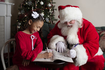 Santa and a little girl coloring together