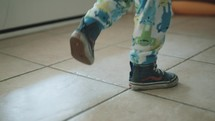 toddler boy stomping his feet
