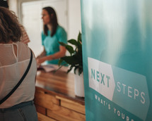 Next steps conference check in counter