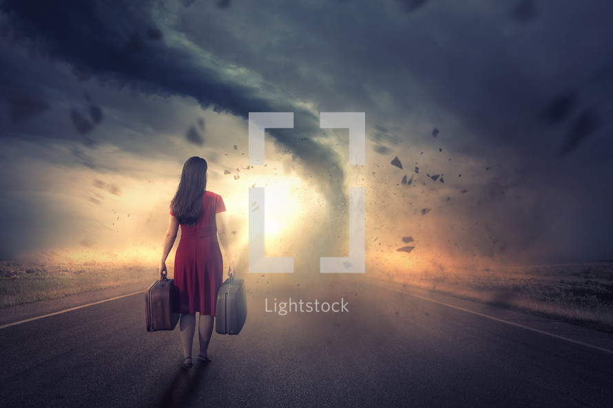 Woman walks towards a tornado and bright sunset