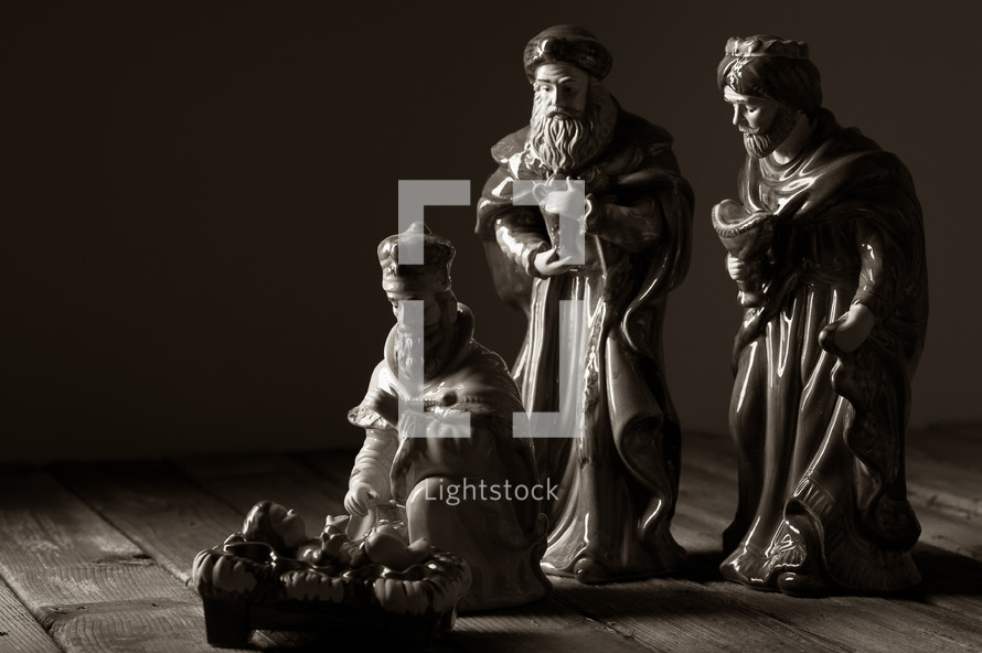 wise men and baby Jesus in a manger