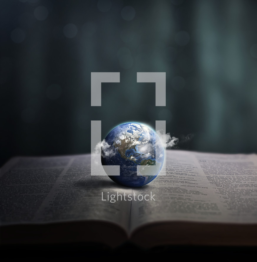 Planet earth on the spine of an open Bible.