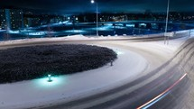 time-lapse of cars moving through a roundabout