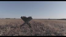 empty manger in field