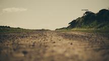 Dirt road. Journey. Destination.  Traveling.