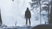 man standing outdoors in falling snow