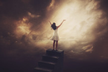 a woman standing at the top of stairs to heaven