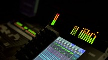 controls and meters on a soundboard