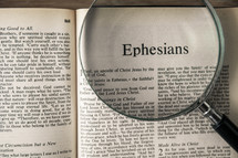 magnifying glass over Bible - Ephesians