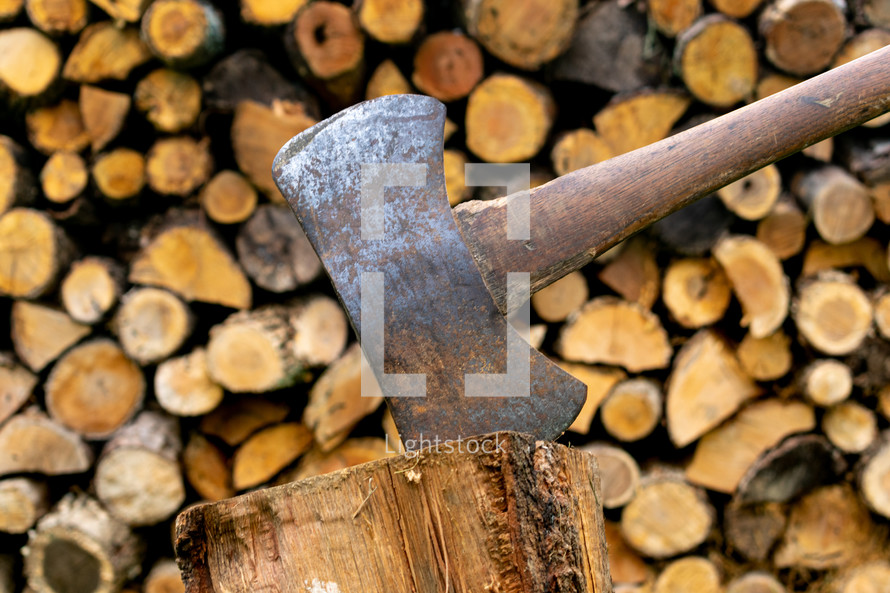 ax and wood pile