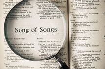 magnifying glass over Bible - Song of Songs