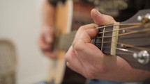 a man strumming a guitar