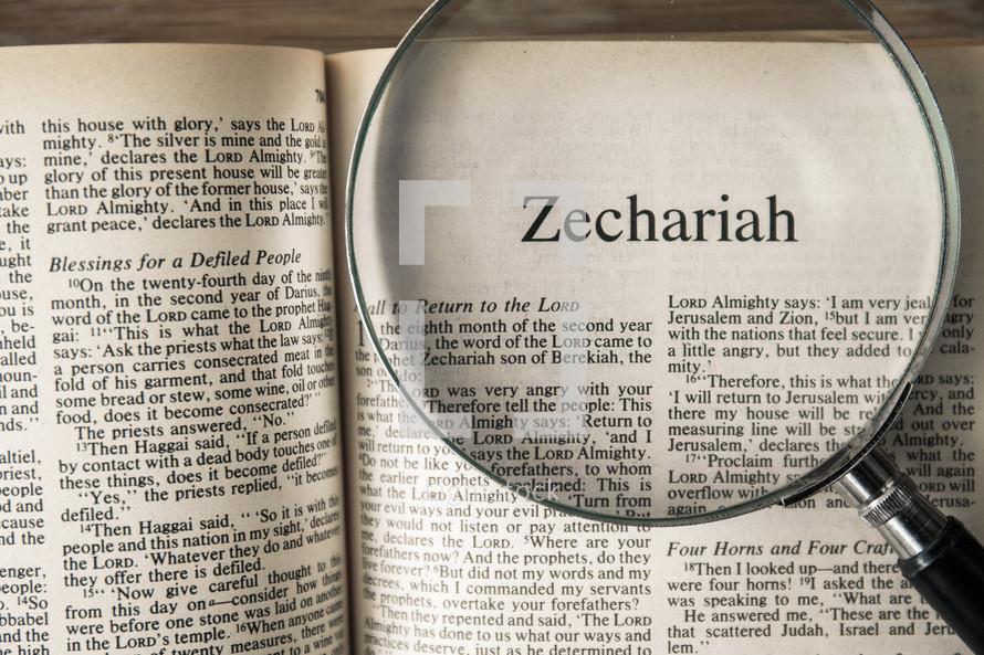 magnifying glass over Bible - Zechariah