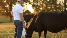 a farmer feeding livestock