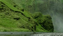 steam blowing in the breeze and mossy shoreline in Iceland