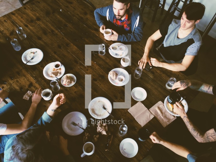family eating a meal together gathered around a table