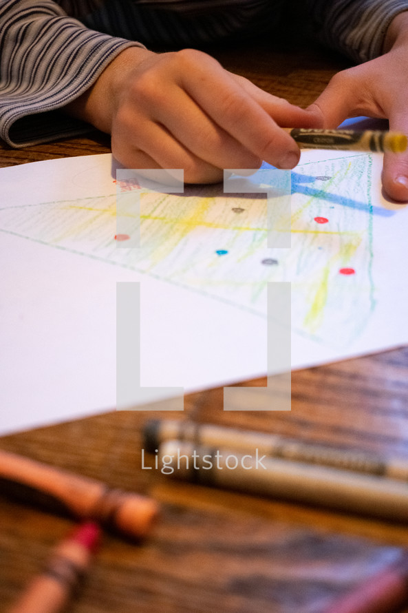 child drawing a Christmas tree