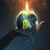 A hand holds up an Earth that is melting from the fire.