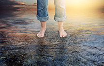 bare feet standing in water