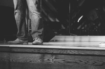 a man's feet standing on stage