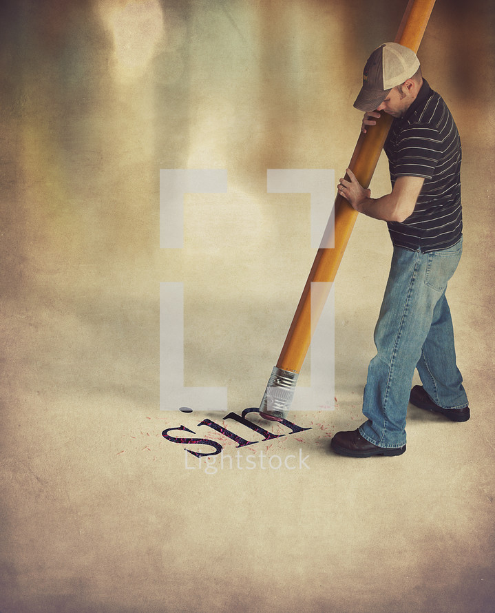 man holding a giant pencil erasing the word sin