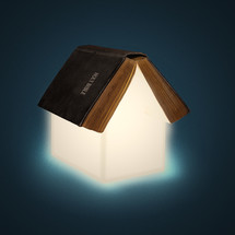 A house of light coming from a Bible