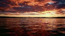 flowing ocean water at sunset