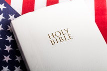 Holy Bible on an American flag