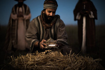 a wiseman presenting a gift to baby Jesus