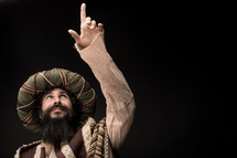 a wiseman pointing up