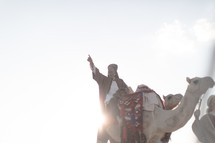 wisemen traveling on camels pointing up