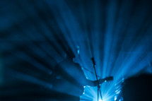 rays of spotlights on a musician at a concert
