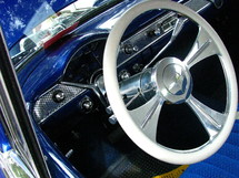 Chrome steering wheel in a vintage car.