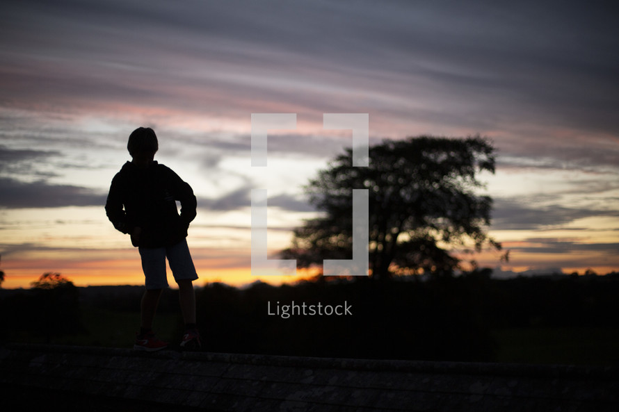 silhouette of a child at sunset